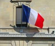 在门面的法国旗子 免版税库存图片