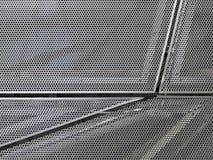在门面的穿孔的金属盘区 图库摄影
