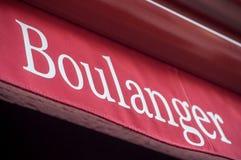 在门面面包师的面包店标志用法语 库存照片