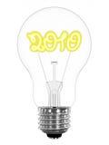 在闪耀的电灯泡里面的2010个数字 库存照片