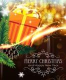 在闪耀的背景的橙色圣诞节礼物 免版税库存图片