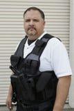 在防弹背心的治安警卫 免版税库存照片