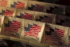 在阳光下倾斜的老邮票 免版税图库摄影