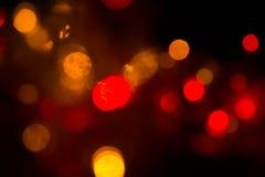 在阴影的抽象背景电灯泡多颜色bokeh 库存照片
