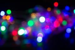 在阴影的抽象背景电灯泡多颜色bokeh 库存图片