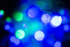 在阴影的抽象背景电灯泡多颜色bokeh 免版税库存图片