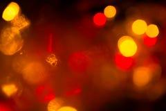 在阴影的抽象背景电灯泡多颜色bokeh 免版税图库摄影