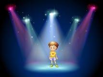 在阶段中间的一个小人与聚光灯 库存照片