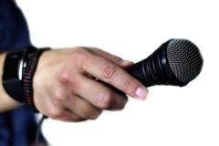 在阶段手举行的话筒 图库摄影