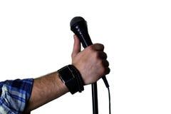 在阶段手举行的话筒 免版税图库摄影