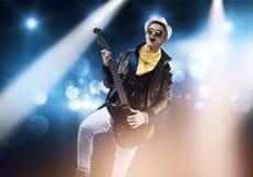 在阶段的摇滚明星 免版税库存图片