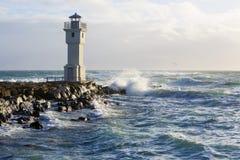 在阿克拉内斯,冰岛港的灯塔  库存图片