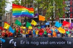 在阿姆斯特丹运河游行的COC Nederland小船2014年 免版税库存图片