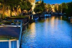 在阿姆斯特丹运河的日落  免版税图库摄影