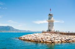 在阿拉尼亚,土耳其港的灯塔  库存照片