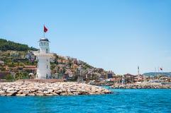在阿拉尼亚,土耳其港的灯塔  免版税库存照片