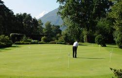 在阿斯科纳高尔夫球场的Golfplayers Lago的Maggiore 图库摄影
