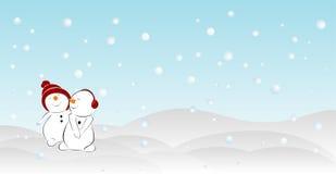 在随风飘飞的雪的两个雪人 免版税库存图片
