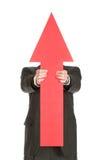 在隐藏的红色之后的箭头 免版税库存照片
