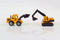在隔绝的挖掘机玩具 免版税图库摄影