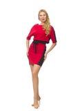在隔绝的红色黑礼服的美丽的夫人 免版税库存照片