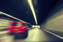 在隧道的汽车通行 库存照片