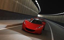 在隧道的红色跑车 图库摄影