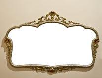 在难看的东西墙壁上的古色古香的镜子 免版税图库摄影