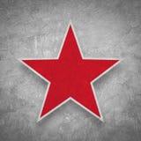 在难看的东西混凝土背景的红色星 免版税库存图片