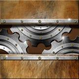 在难看的东西背景的金属齿轮 免版税图库摄影