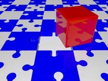 在难题的红色立方体在蓝色和白色颜色编结 免版税库存图片