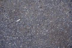 在雨,灰色以后的湿沥青 免版税库存图片