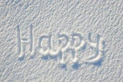 在雪写的愉快的文本为纹理或背景-寒假概念 晴天,与阴影的明亮的光,平的位置,上面 免版税库存图片