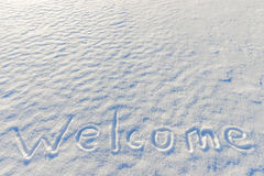 在雪写的词欢迎 库存图片