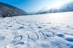 在雪写的2018个数字 免版税库存图片
