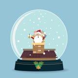 在雪地球的圣诞老人烟囱 库存图片