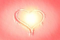在雪得出的心脏形状 库存图片