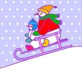 在雪撬的雪人 库存图片