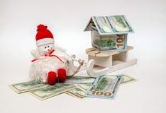 在雪撬的雪人 免版税图库摄影
