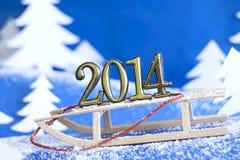 在雪撬的2014个新年数字 图库摄影