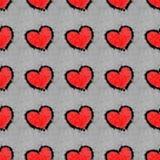 在雪无缝的样式画的红色心脏 免版税库存照片