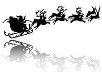 在雪橇的圣诞老人驱动 免版税库存照片