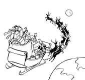 在雪橇观看的橄榄球的圣诞老人 免版税库存图片