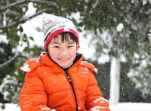 在雪的一个儿童游戏 免版税库存照片