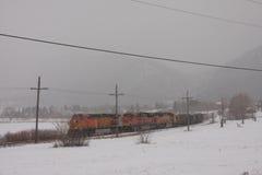 在雪的伯灵屯北圣菲火车 库存照片