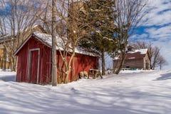 在雪的农村农厂场面 免版税库存照片
