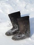 在雪的冬天鞋类 库存照片