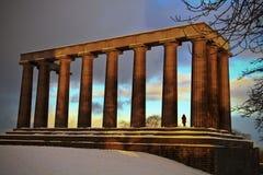 在雪的古希腊结构 库存照片