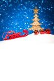 在雪的圣诞节装饰品在闪烁背景 库存图片