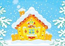 在雪的小日志小屋 图库摄影